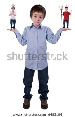 Angel and devil in a young boys hands isolated over white - stock photo
