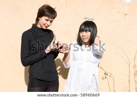Angel and devil together - stock photo