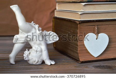 Angel and heart - stock photo