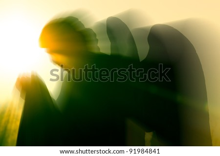 angel and intense light - stock photo