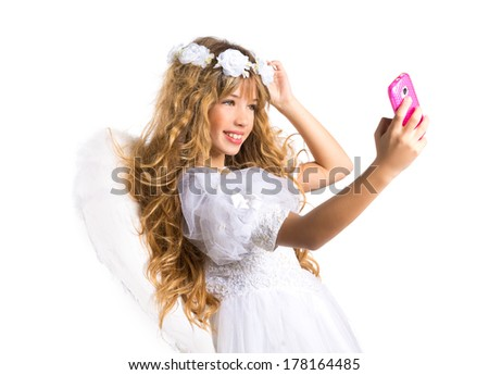 Angel blond girl taking picture mobile smartphone and feather wings on white byod to heaven - stock photo