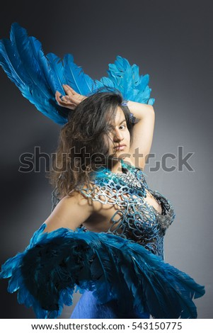 Angel, Brunette woman in costume made of blue feathers, wild and free bird, fantasy image