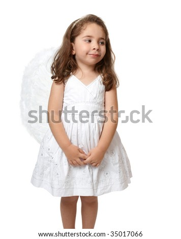 Angel child dressed in white looking sideways.