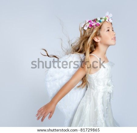 Angel child girl with wind in hair - stock photo