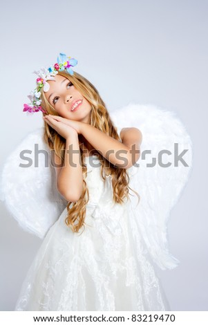 Angel children blond girl with sleeping hands gesture - stock photo