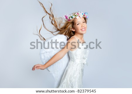 Angel children girl with white wings and flowers crown - stock photo