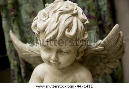 Angel. Closeup of marble sculpture. Contemplating angel. - stock photo
