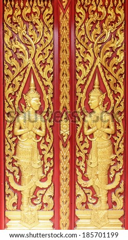 Angel decoration of buddhist temple door  in surat thani,thailand - stock photo