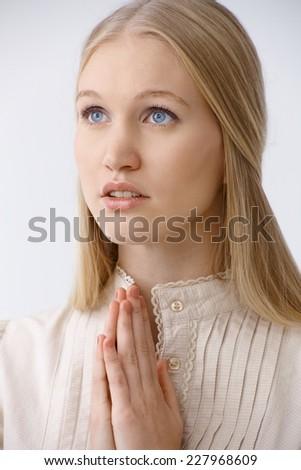 Angel face woman praying, looking up. Closeup photo. - stock photo