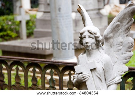 Angel guarding graveyard - stock photo