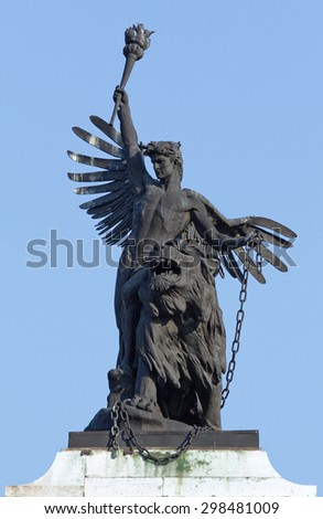 Angel keeping a torch sculpture with a lion. - stock photo