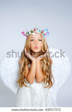 Angel little girl blowing expression with wings - stock photo