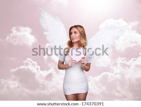 Angel of love, beautiful girl with great white feather wings in the heaven, pink cloudy sky, Valentine day, romantic holiday concept