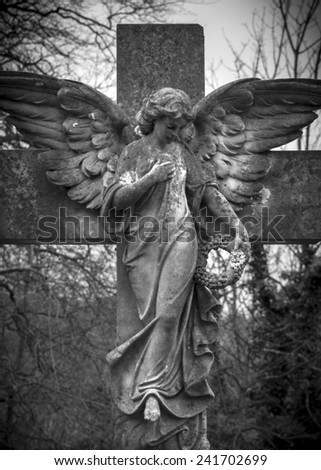 Angel on a Cross - stock photo