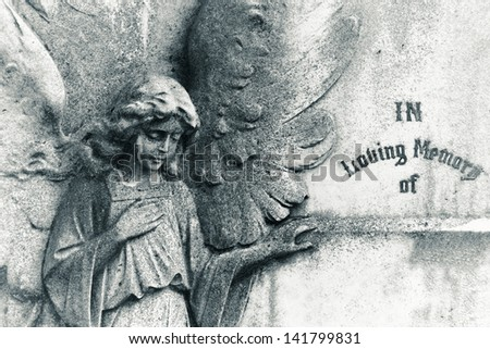 Angel on blank headstone - stock photo