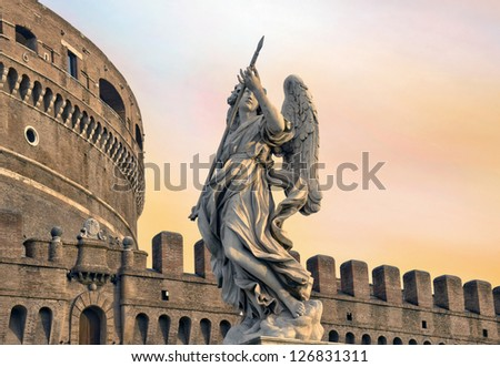 Angel on guard of Rome, statue of an angel on the background Castle Sant'Angelo, Rome, Italy - stock photo
