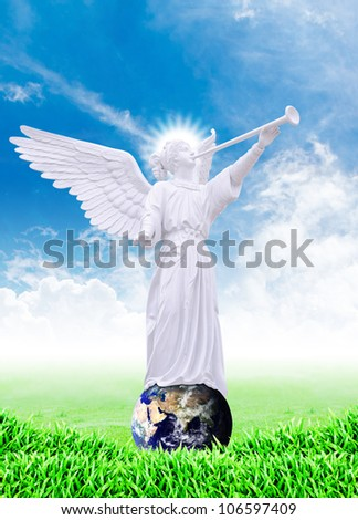 Angel on the world isolated : Elements of this image furnished by NASA - stock photo