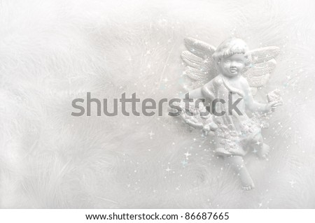 angel on white feather background with sparkles