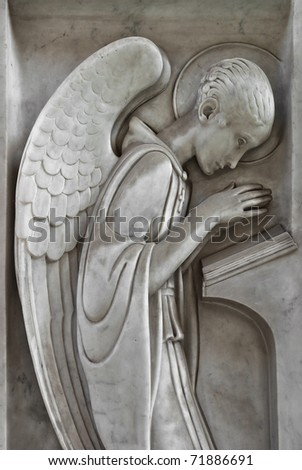 angel praying and reading - stock photo