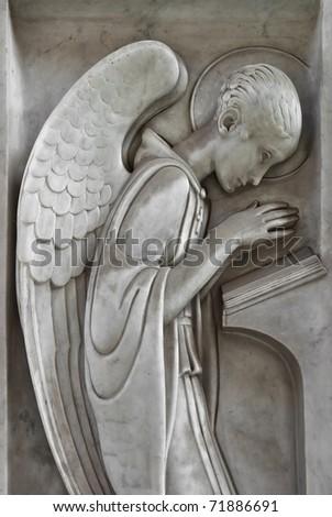 angel praying and reading - stock photo