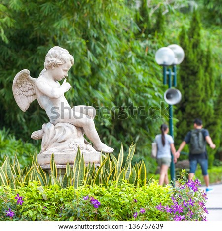 Angel sculpture in the park in Hong Kong - stock photo