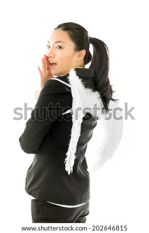 Angel side of a young Asian businesswoman whispering message with cupping hand over mouth isolated on white background - stock photo