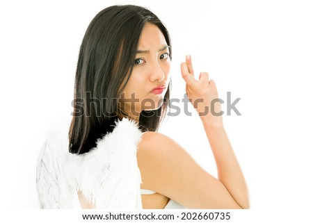Angel side of a young Asian woman turning back and making her fingers crossed