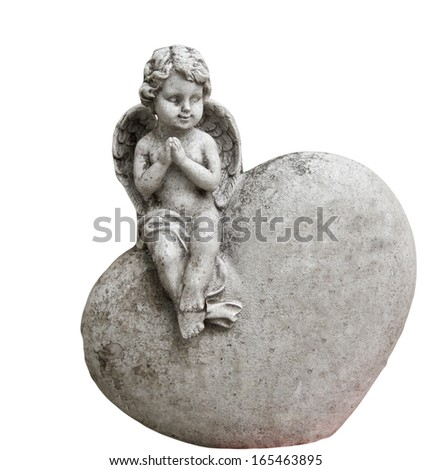 Angel sitting on a heart - stock photo