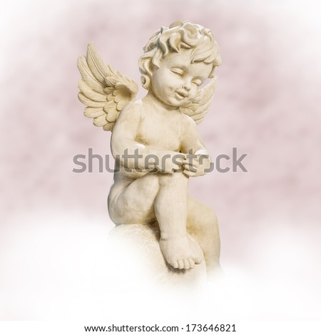 angel sitting on cloud. pink background  - stock photo