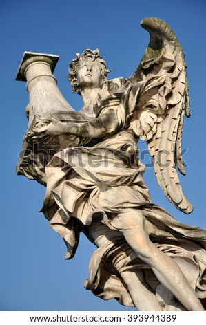 Angel statue against blue sky. Rome, Italy