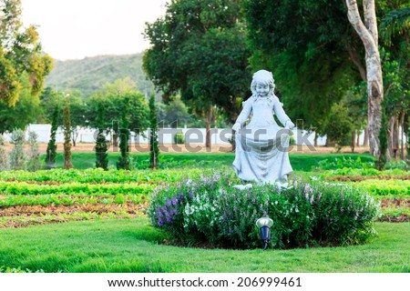 Angel statue in the garden - stock photo