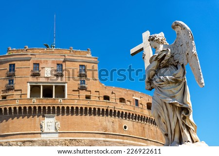 Angel statue on a bridge in front of the Castel Sant`Angelo in Rome, Italy - stock photo