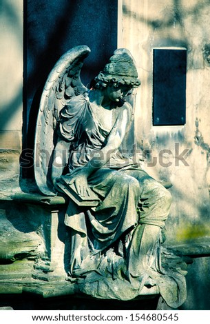 Angel statue on Cemetery in Europe - stock photo