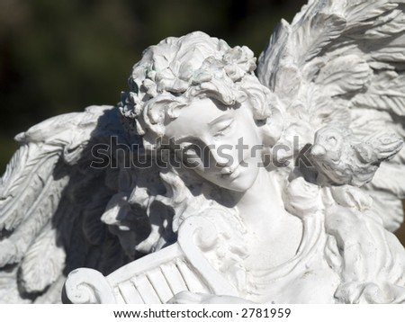 angel with a harp - stock photo