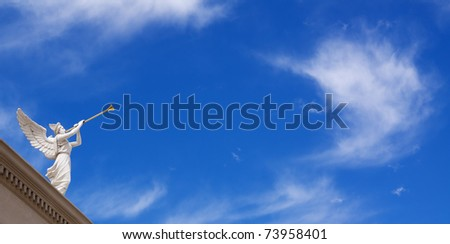 Angel with horn on blue sky background with white clouds
