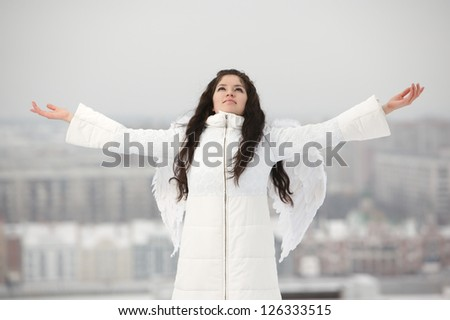 Angel with raised hands looking up