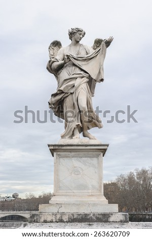 Angel with the Sudarium (Veronica's Veil) is a statue on the Ponte Sant'Angelo in Rome, Italy. Ponte Sant'Angelo is a bridge in front of the Castel Sant'Angelo. - stock photo