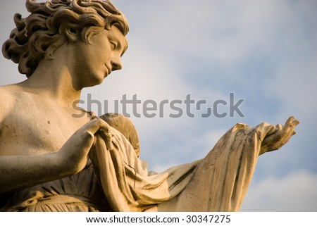 Angel with the Sudarium (Veronicas Veil). Situated on the bridge of Castel Sant'Angelo, Rome Italy. XV Century. - stock photo