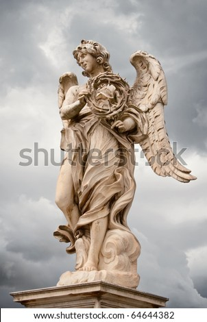 Angel with the thorn crown statue by Bernini on Ponte Sant'Angelo - stock photo