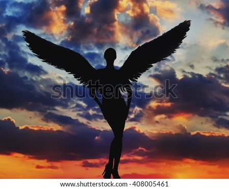 angel with white wings in the dramatic sky