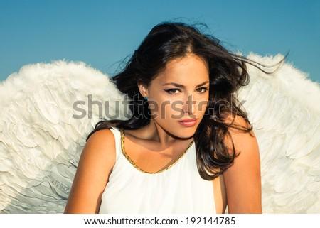 angel woman against blue sky - stock photo