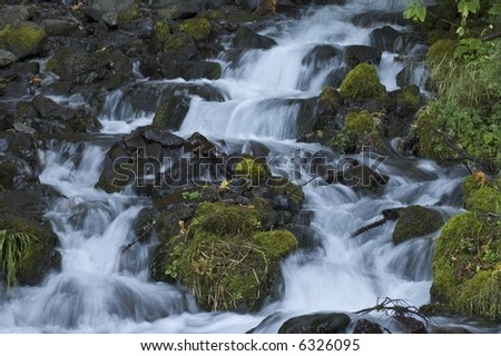 Angelic flowing waters in the National Scenic area of the Columbia River Gorge in Oregon. - stock photo