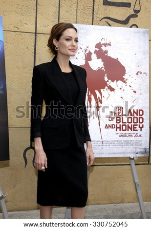 Angelina Jolie at the 2012 Golden Globe Foreign Language Film Panel Discussion held at the Egyptian Theatre in Hollywood, USA on January 14, 2012. - stock photo