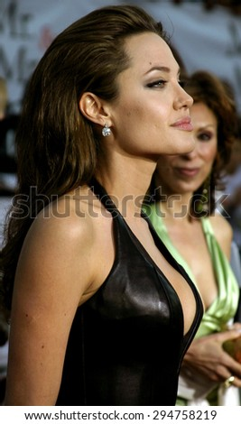 """Angelina Jolie attends the Los Angeles Premiere of """"Mr. & Mrs. Smith"""" held at the Mann's Village Theater in Westwood, California on June 7, 2005.   - stock photo"""