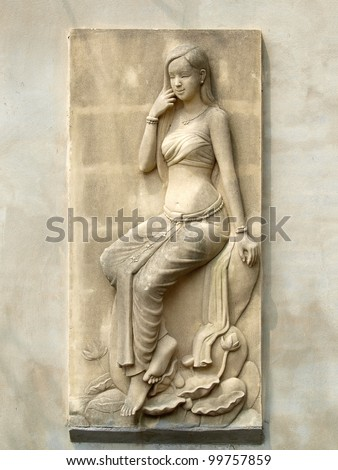 angels, carved sandstone in a thai temple. - stock photo