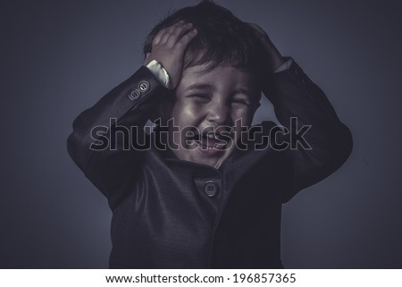 anger, little business boy over grey background - stock photo