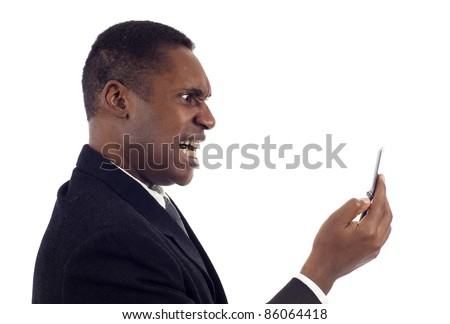 Anger - Side view of African American business man screaming on the phone isolated over white background - stock photo