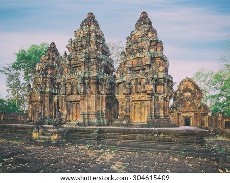 Angkor Banteay Srei temple detailed carvings, Cambodia. Creative tonning effect - stock photo