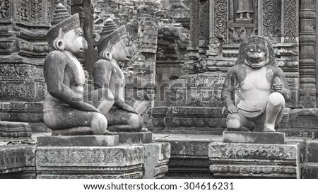 Angkor Banteay Srei temple guardian statues, Cambodia. Monochrome horizontal shot - stock photo