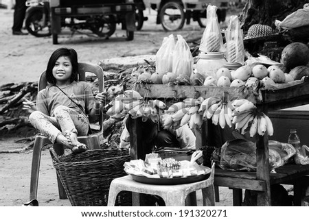 ANGKOR, CAMBODIA - APR 7: Child selling fruit outside Angkor Temple. On April 7, 2014.